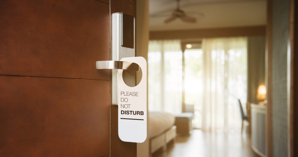 Masonite Architectural Acoustic Blog Hospitality Image of Hotel Door and Do not Disturb sign